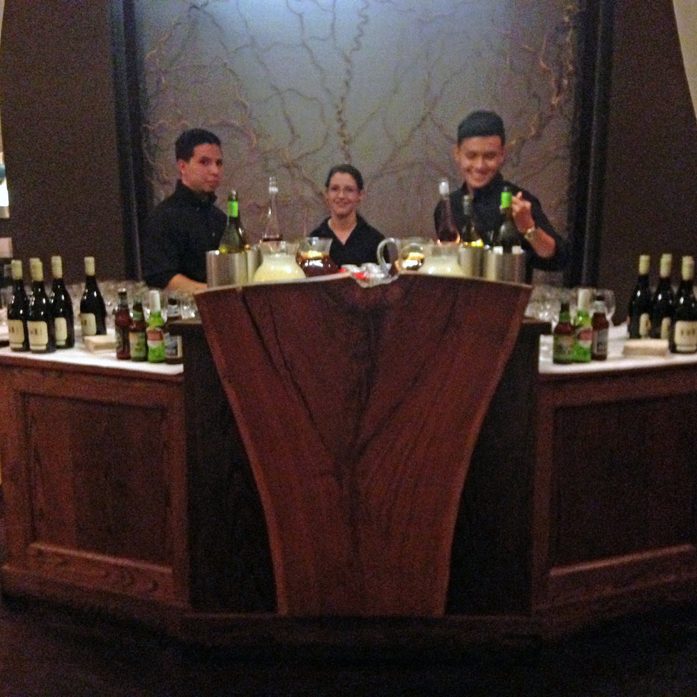 front desk bar with 3 people.JPG