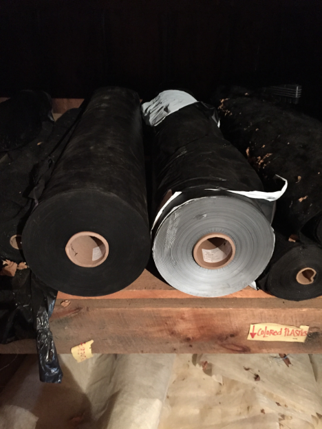 Black and white-on-black plastic mulch rolls waiting for their day!