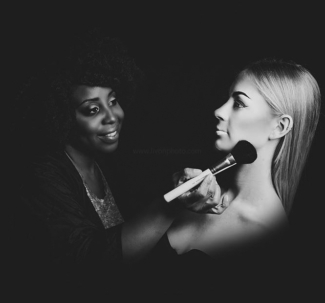 TeQuana Colvin applying makeup to model.