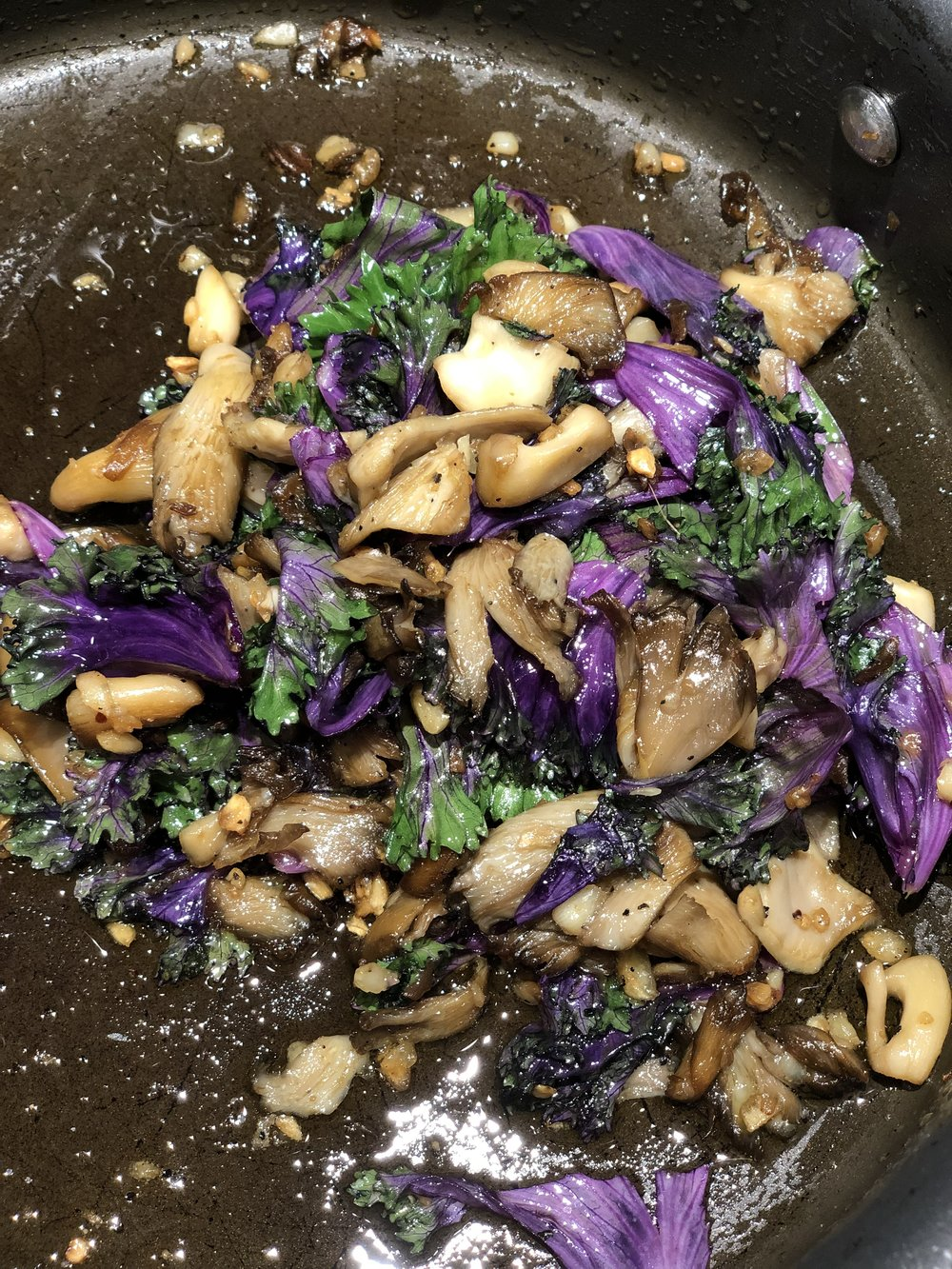 Saute garlic 3-5 min on low, add mushrooms and brown on medium-high for 5 min, and add kale for 5 min