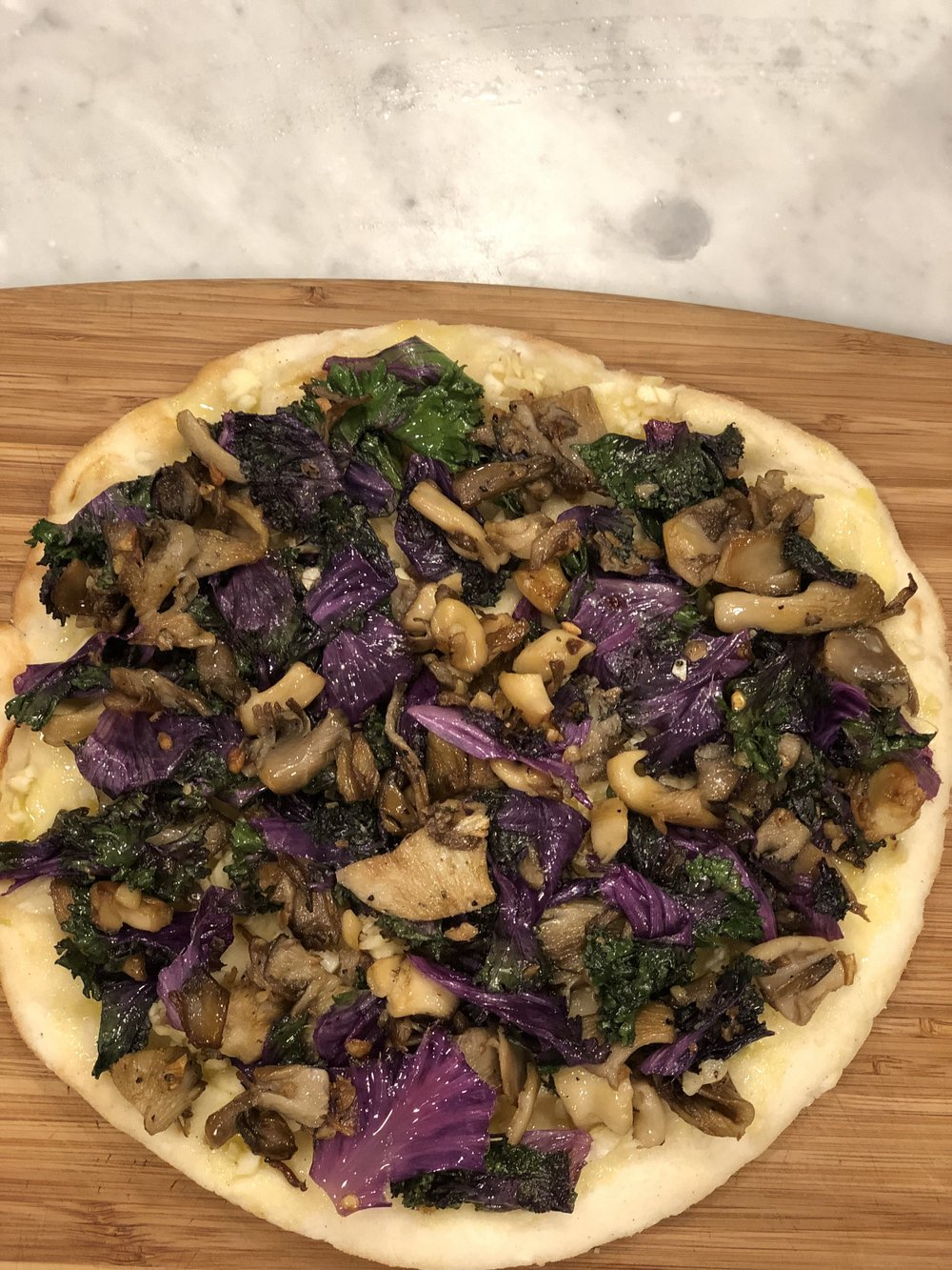 Layer on garlic, mushrooms and kale