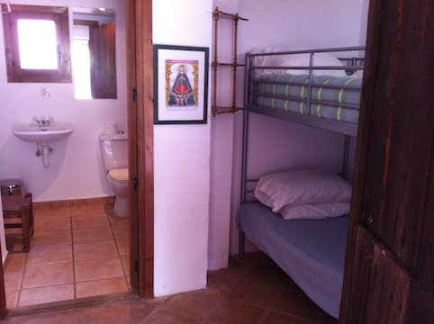 The tiny bunk room, with adjoining bathroom.