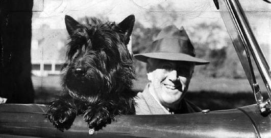 Franklin D. Roosevelt and Fala.