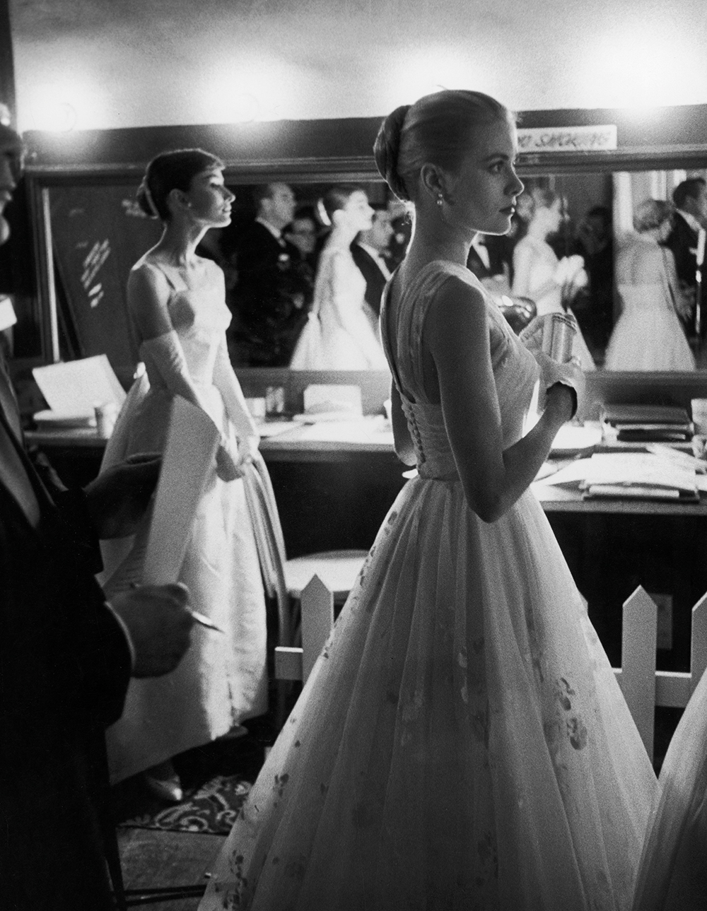 Audrey Hepburn and Grace Kelly backstage at the 1956 Academy Awards.