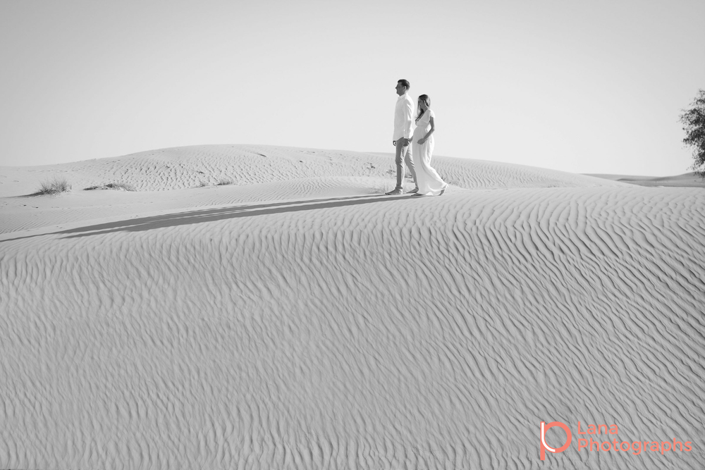 Dubai Maternity Photography portrait of expectant couple posing in the desert