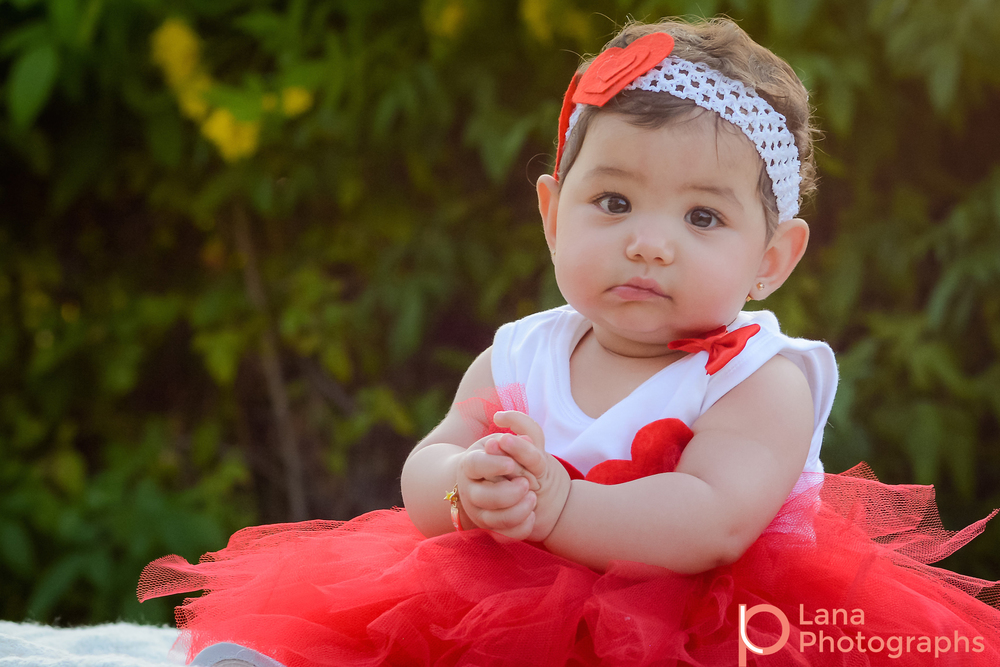 Dubai Family Photography portrait of a little baby girl in red tutu in the park