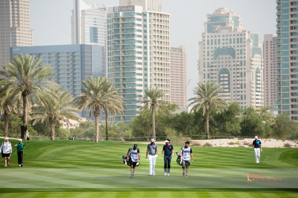 European PGA tour players walking across the Emirates Golf Course grounds during the Omega Dubai Desert Classic in Dubai February 2017