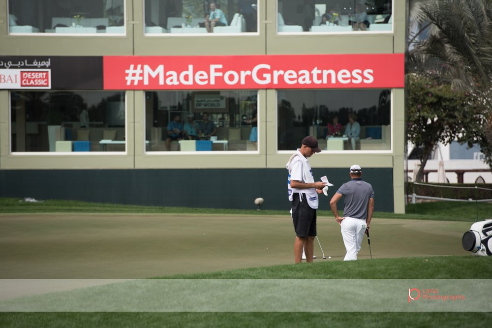 Grégory HAVRET  stands in front of the #madeforgreatness sign at the Omega Dubai Desert Classic in February 2017