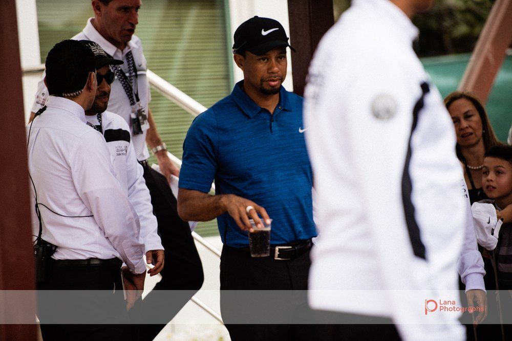 Tiger Woods leaves the organizers office and walks to his car during day 1 of the Omega Dubai Desert Classic in February 2017