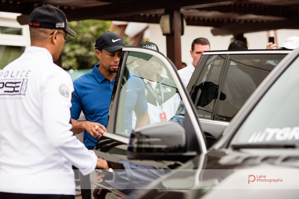 Tiger Woods enters his SUV during day 1 of the Omega Dubai Desert Classic in February 2017