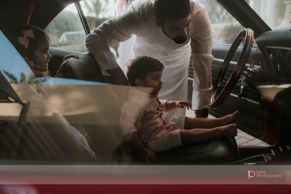 Lana Photographs Family Photographer Dubai Top Family Photographers father and son in Camaro ss68