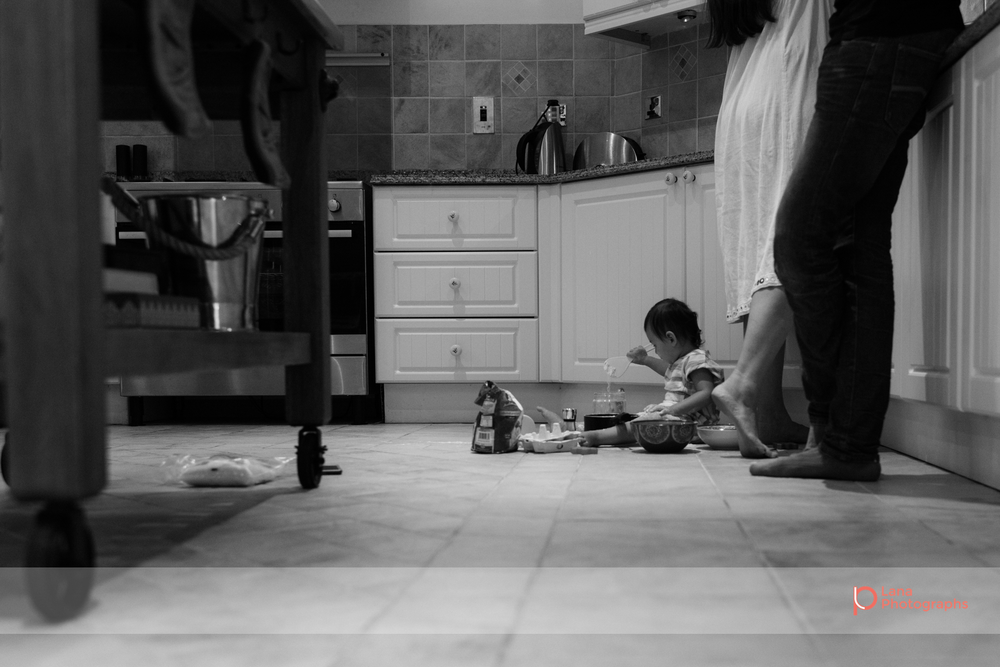 Lana Photographs Dubai Family Photographer image of little girl sitting on kitchen floor