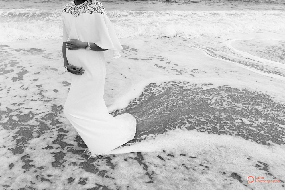 Lana Photographs Dubai Maternity Photographer image of a pregnant woman in shallow ocean water