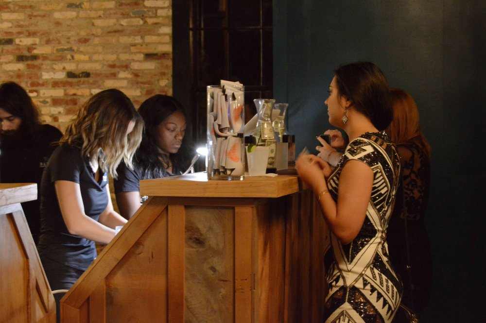 Alpha Omicron Pi sister ordering drink from B&B Bartenders.
