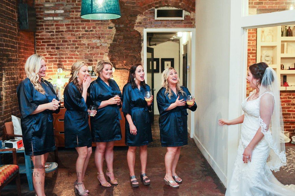 We loved their matching silk robes! Kara revealed her wedding day attire to her ladies in the bridal suite and their reactions were priceless.