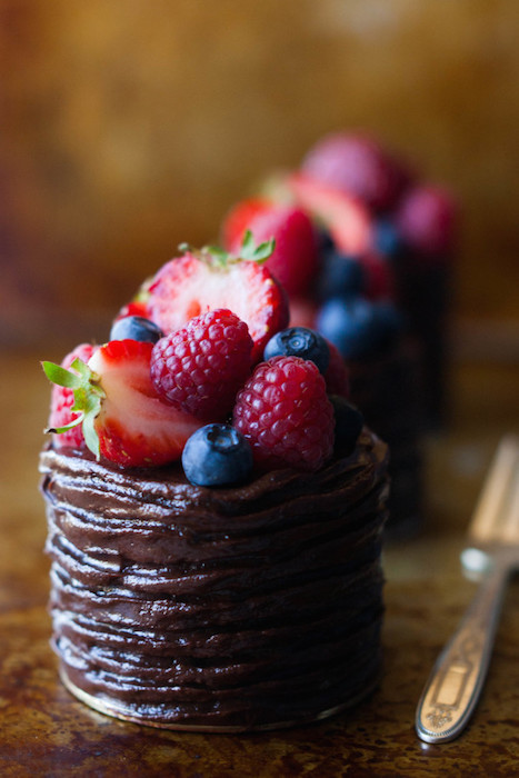 chocolate and berries are always a wining duo. present guests with these stunning bite sized desserts that are both delicious and photogenic.  - Image Credit: Intimate Weddings