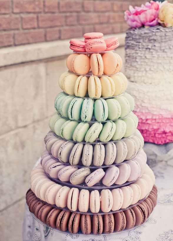 macaron? yes, please! get creative with the color scheme of your macaron tower to leave guests in awe of the presentation. whether you do classic all ivory, ombre or rainbow, you can't go wrong with this airy dessert option. - Image Credit:: Wilkie