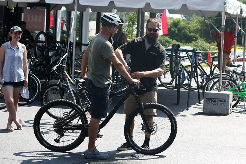 "Rick helping out a customer at last weeks ""Back To School"" Bike Swap."