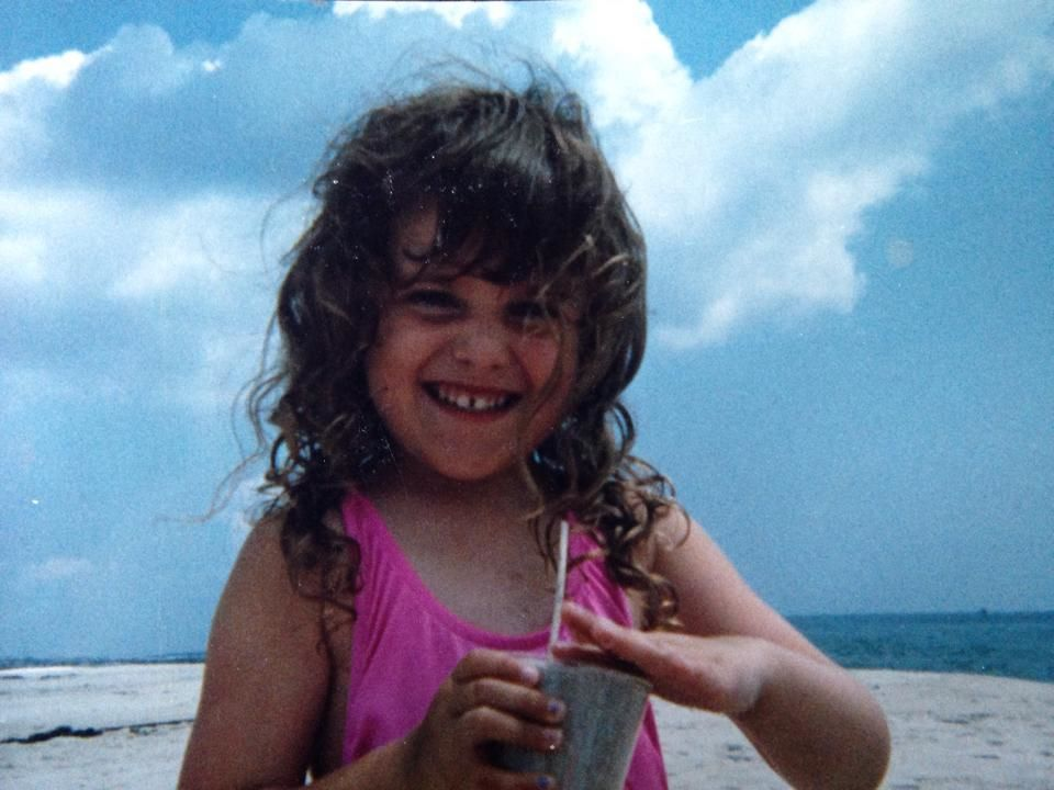 Me as a little girl packing a sand smoothie...mmm mmm.