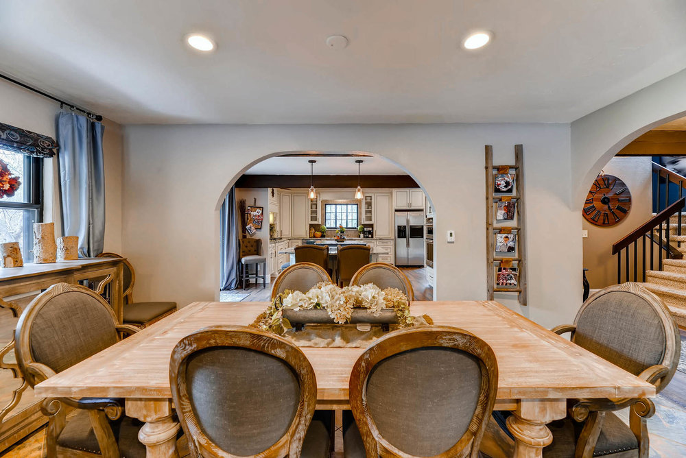 AFTER - The archways were enlarged and the window and cabinetry were centered.