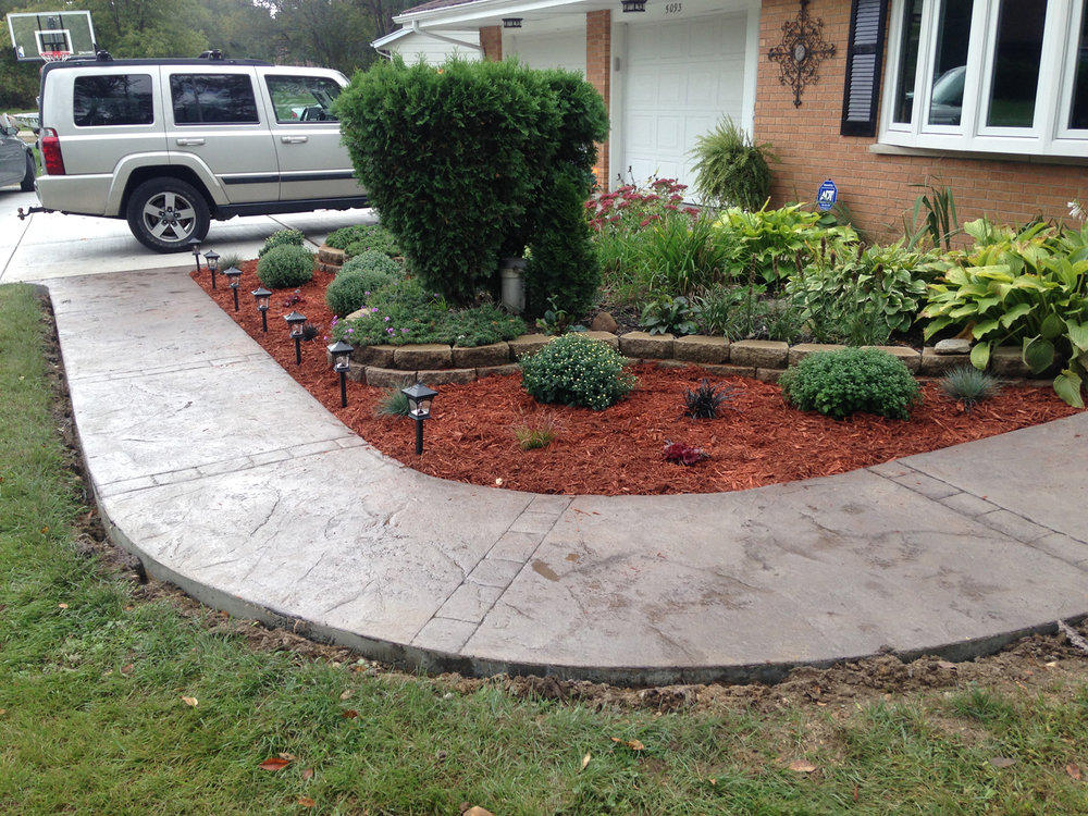 Fresh placement, such as this walkway, stamped using Color Hardener, is the staple for many concrete contractors. Often times, it is easily incorporated into a larger landscaping renovation project. Job By Concrete Stamper - click image to view their profile.