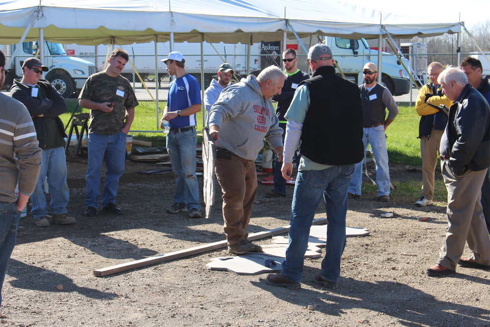 Steve Johnson demonstrates proper stamp layout prior to stamped concrete training at a Solomon Colors/Brickform training event.