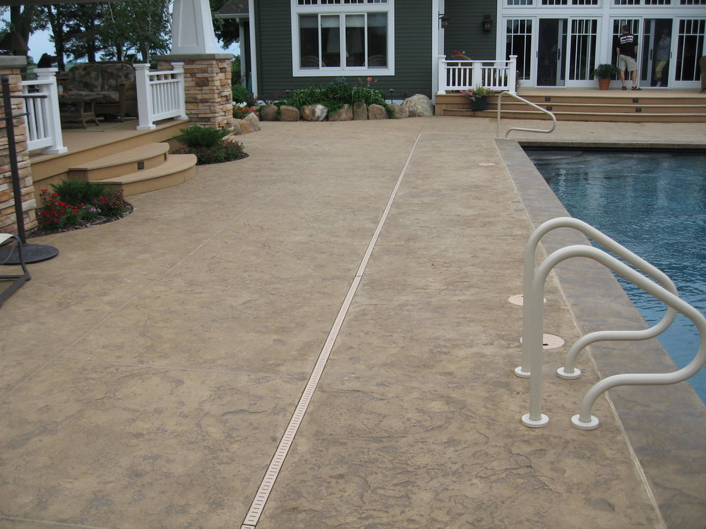 Texture skins with decorative sawcuts allow you to stamp concrete with less time and labor expense. Photo courtesy of Power Concrete Construction & Design.