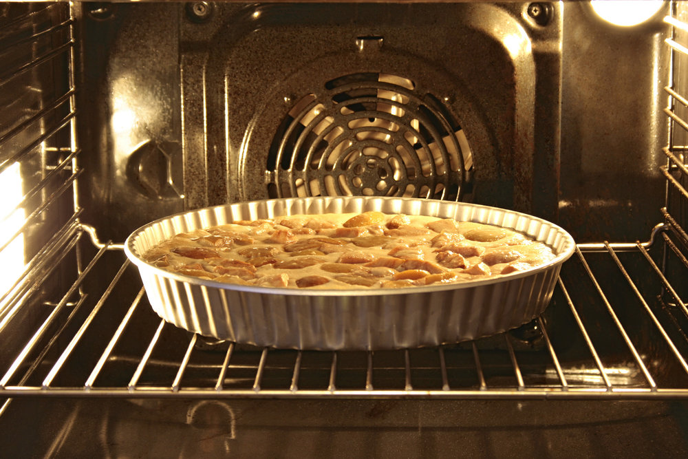 stock-photo-apple-pie-in-an-oven-30719215.jpg