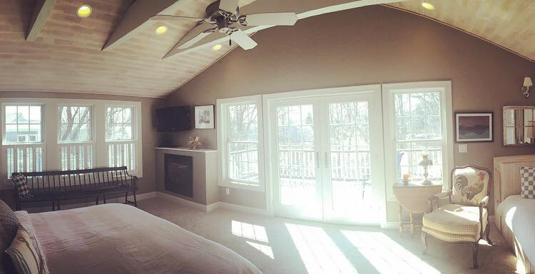 I love the vaulted ceilings in this bedroom, as well as the walk out to the deck.