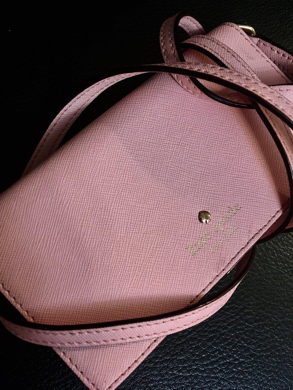 The ubiquitous pink wallet/purse