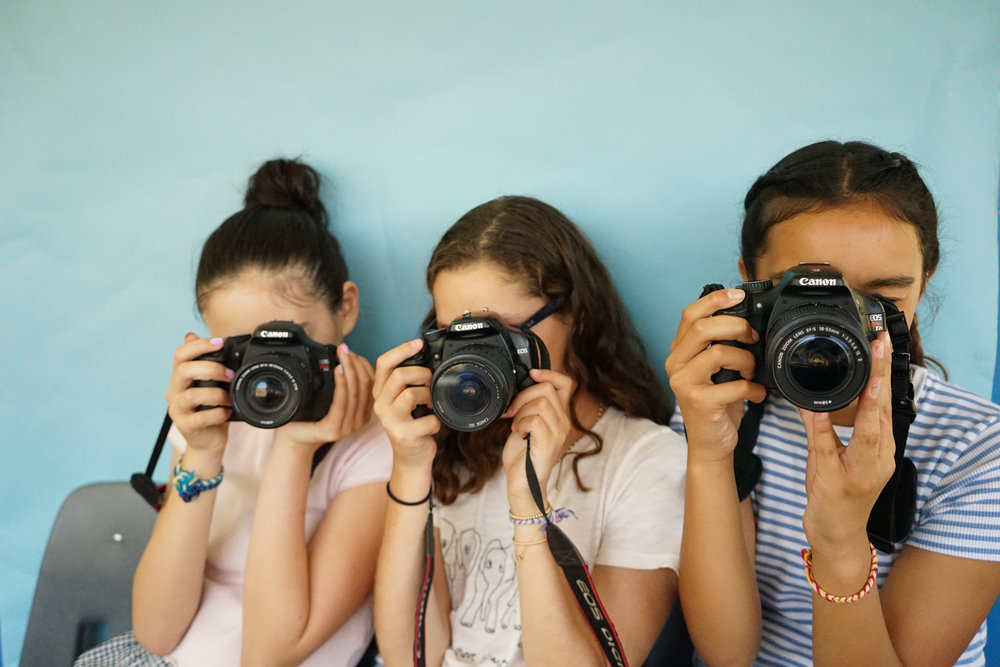 FILM & PHOTOGRAPHY - Girls learn extensive photography and film making skills. Highlights include filming and directing a music video and learning photo editing skills including Adobe Photo Shop and Final Cut Pro.