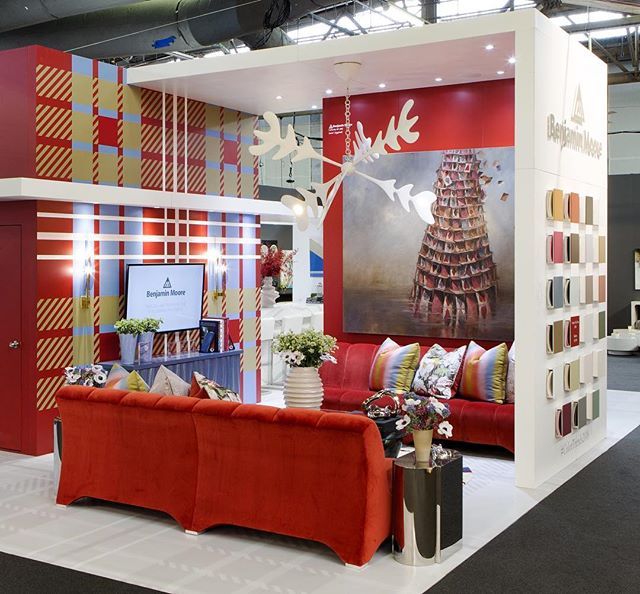DEFINING PLAID IN 2018!  A classic reinterpreted by @bonniejstevesinteriordesign for the @benjaminmoore  2018 Booth using Caliente AF-290 and their Color Trends 2018 palette for the @ADDesignShow. When approached by Benjamin Moore with the assignment of creating a new and bold booth design - a design that would display the versatility an vitality of Color Trends 2018 - we took on the task of the project with pragmatism, sophistication and style.  Never compromising the overall sense of fun. . . .  Bespoke sofas by @upholsteryservices_ny  featuring a plush velvet available at@zimmerandrohde_usa Chandelier and coffee table by #AlexandreLoge and painting by @joeconcra available at @donzella_ltd  Lighting by @fontanaarte available @silbermanfred  Decorative painting on the cabinet by @muralsbypatrice Side tables @johnlyledesign  Flowers by @blondiestreehouseinc Stripe pillow @donghia_inc Floral pillow from @romo_fabrics  Curated with support by  @incollect Bar area by @cambriasurfaces with barstools by @roomandboard  Photo Credit: Jonas Gustavsson @jonas_snapsalot