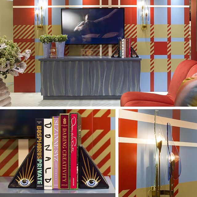 Mad for Plaid!  A bold and sophisticated booth designed by @bonniejstevesinteriordesign for the @BenjaminMoore 2018 Booth using Caliente AF-290 and their Color Trends 2018 palette for the @ADDesignShow. Photo Credit: Jonas Gustavsson @jonas_snapsalot. . . .  Featuring a lacquered cabinet with decorative finishes by @muralsbypatrice  A mixture of flowers from  @blondiestreehouseinc brought the room to life.  A collection of @assouline art books flanked by @lobjet bookends.  The radiant  Dahlia sconces by #maxingrand for @fontanaarate and featured at @silbermanfred #fredsilberman.  @experiencecentury.  Bespoke sofa by @upholsteryservices_ny featuring a plush velvet from @zimmerandrohde