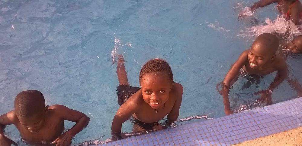 Uganda winners in a swimming pool.jpg