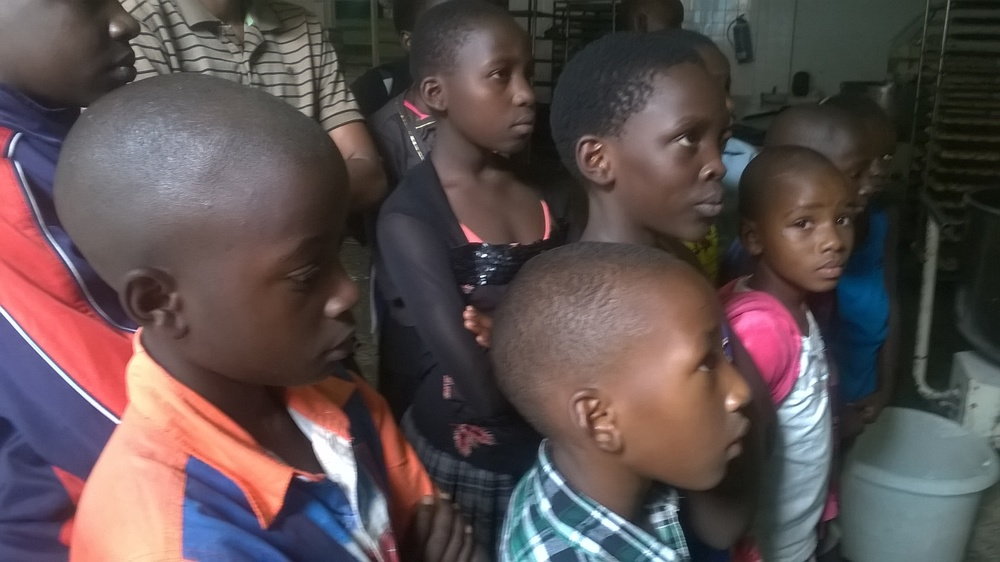 Uganda winners listen to guide at Wildlife Education Center.jpg