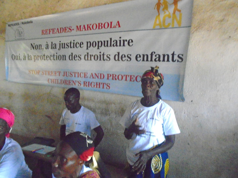 DRC Workshop-woman defending rights   of children.jpg