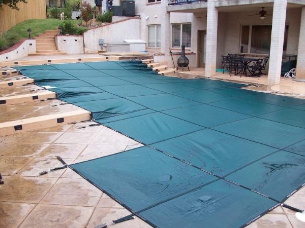 A Country Leisure in-ground pool with protective cover.