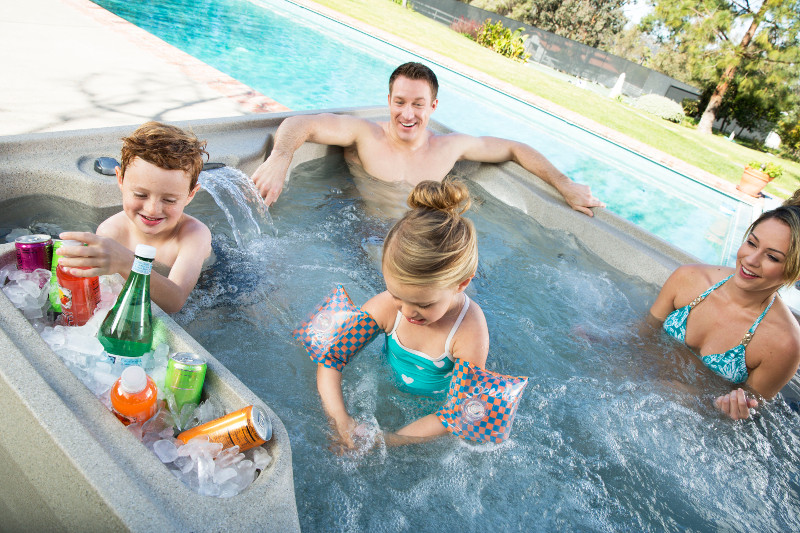Family enjoying their hot tub- Country Leisure