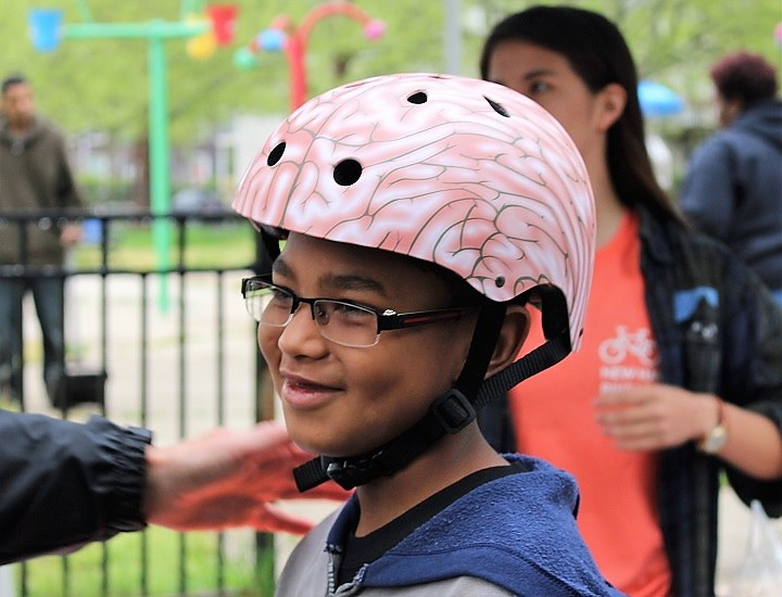 Omarhie Wilson gets a new brain-colored bike helmet.