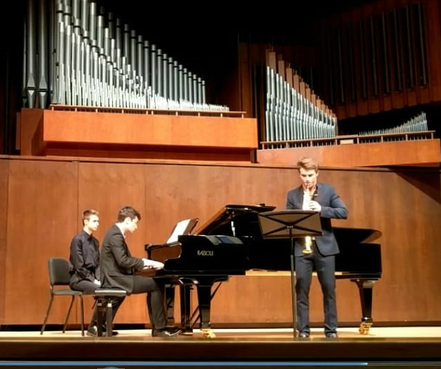 Connor and Will performing    Speaking    at Juilliard's Composer's Concert