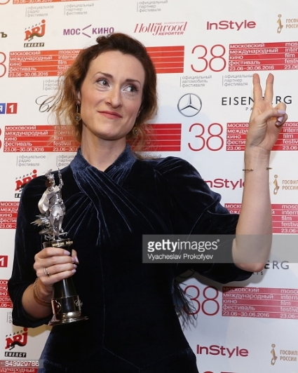 Director Nicole Brending holding the Silver St. George statuette for Best Film of the Shorts Competition at the closing ceremony of the 38th Moscow International Film Festival.  Photo credit: Vyacheslav Prokofyev.