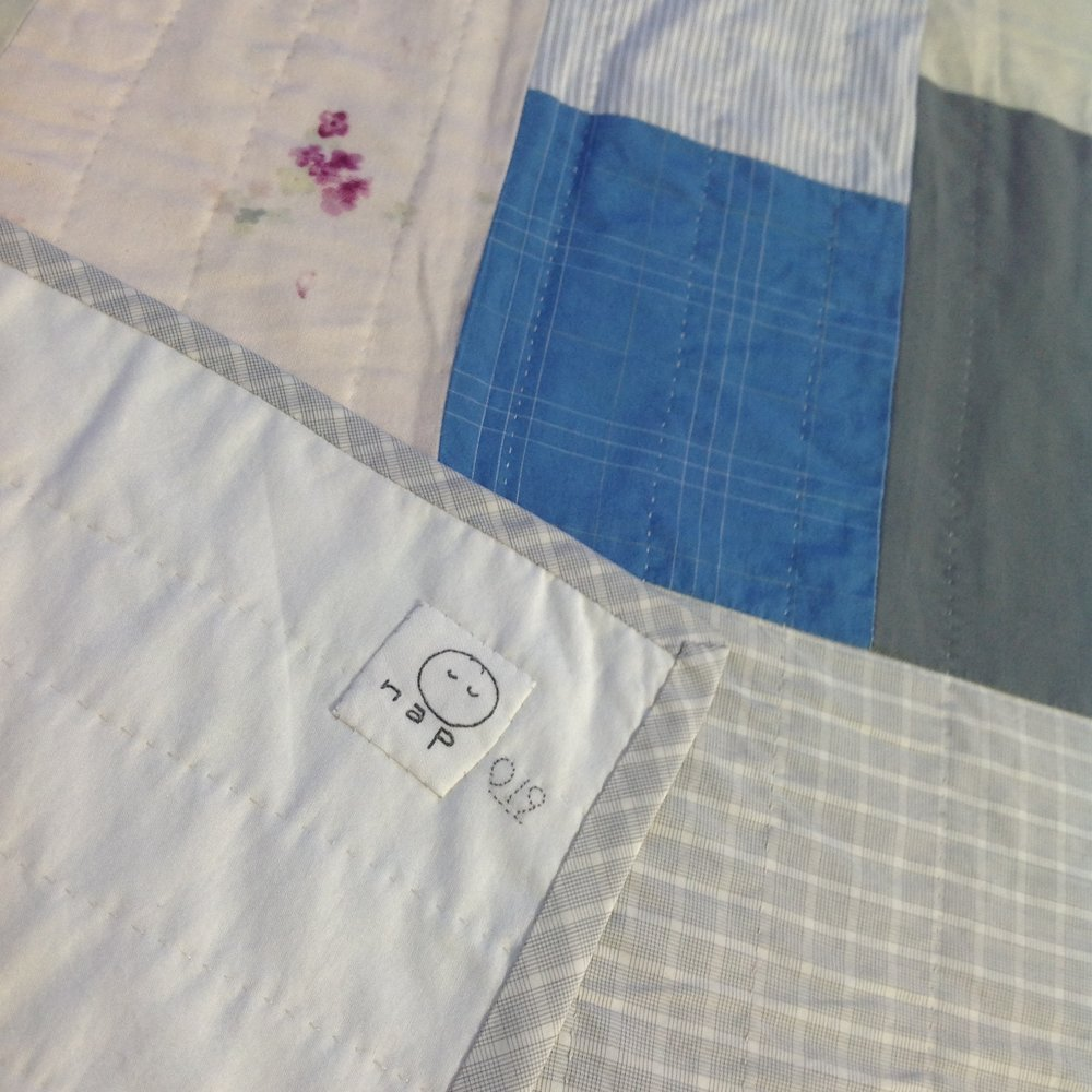 [sold]  nap quilt no. 019 reverse and detail  swiss cotton batiste backing with italian cotton plaid binding