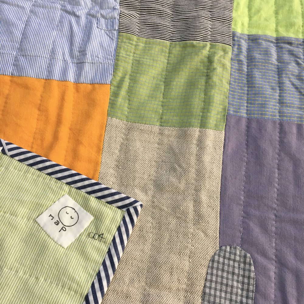 [sold]  nap quilt no. 004 reverse and detail  woven green and white stripes cotton backing with mixed woven binding