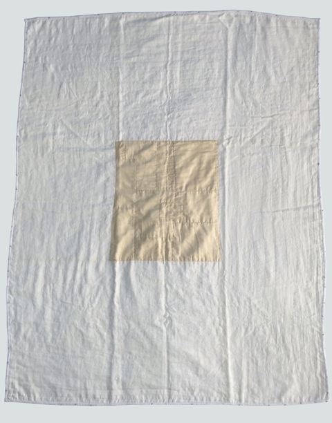 [sold]  nap quilt no. 024  delicate old silk central medallion, improv pieced, (quilting is stitched in the ditch), with an ivory linen surround (quilting is stitched in a concentric path around central medallion)  36x48in / 92x122cm
