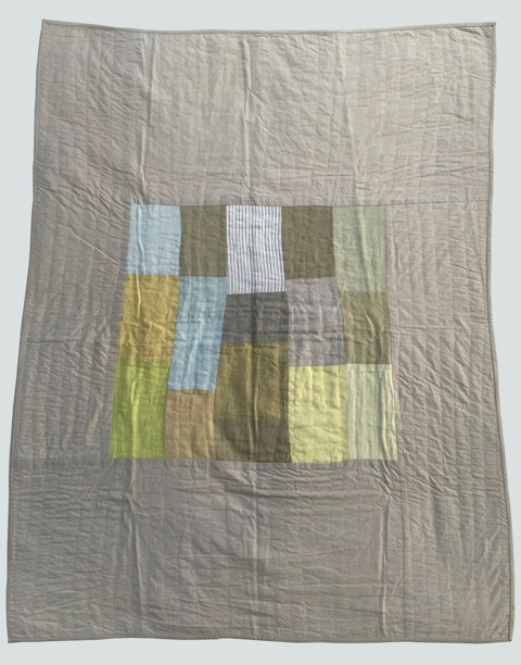 [sold]  nap quilt no. 015  center patches of mixed wovens surrounded by cotton (note: this image does not capture the true soft palette of this quilt; colors are dull here but it's quite dreamy)  36x48in / 92x122cm