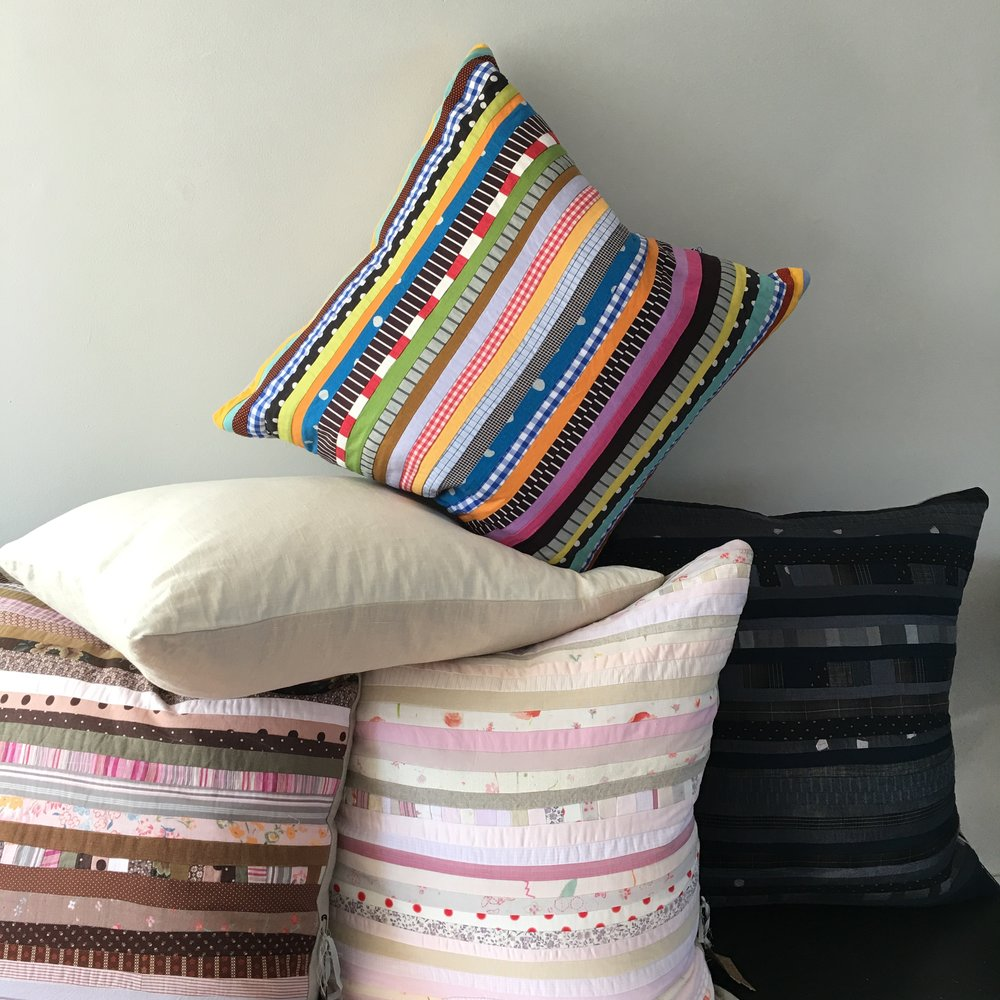 pillows made with natural linen backs, invisible zips, feather and down inserts; sizes vary  i am always making new pillows daily which show up in the gallery but often don't make it to this site. please stop in if you are in provincetown
