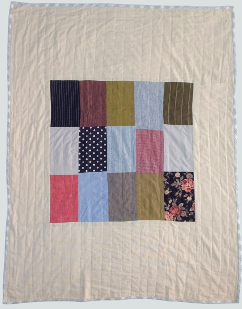 nap quilt no. 006  center of mixed woven and print patches surrounded by shot cotton  36x48in / 92x122cm