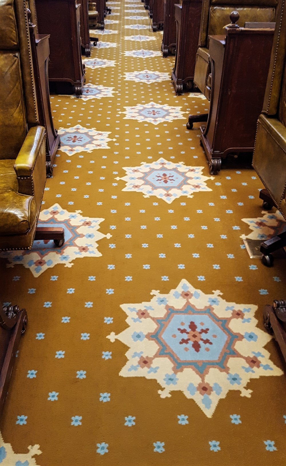 Carpet was installed to protect the tile floor; the carpet matches the tile pattern beneath