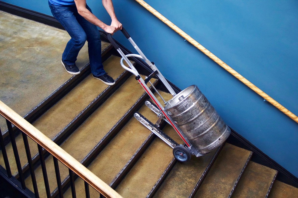 The Glyde hand truck has a pair of treads built into the back, which help it tackle stairs without damaging the cargo or injuring the user.