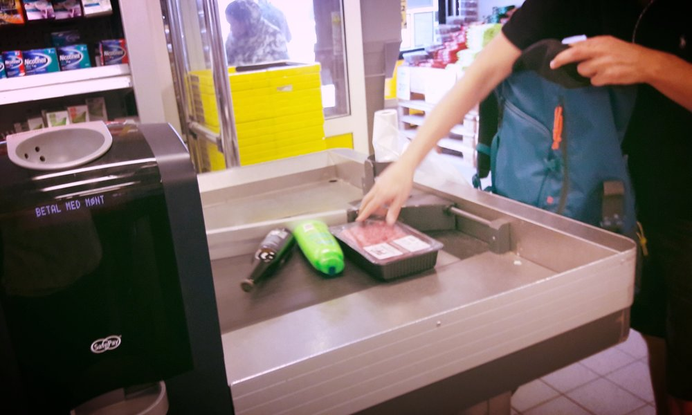 Your groceries will be either swiped left or right by a long metal divider so the cashier can start serving the next customer in line.